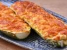 Рецепта Пълнени пресни тиквички с яйца, сирене и кашкавал печени на фурна